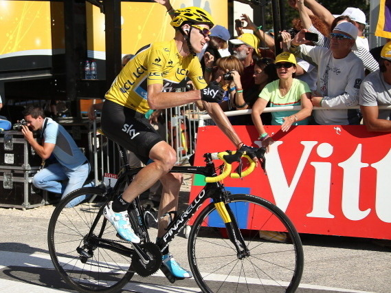 Race leader Chris Froome of Great Britain finishes Stage 20 of the 2013 Tour de France. The penultimate stage of the Tour put Froome ahead by 5 minutes and practically guarantees he finishes Sunday in Paris in the yellow jersey.