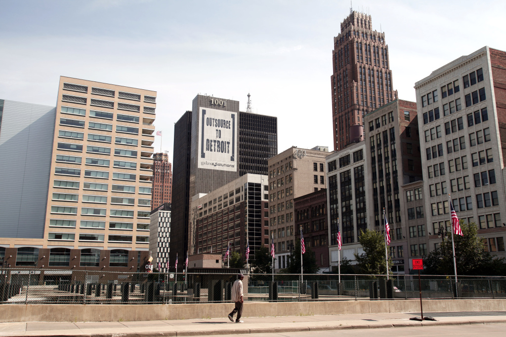 A banner on a building in downtown Detroit is shown  July 18, 2013 in Detroit, Michigan. Detroit today filed for Chapter 9 bankruptcy, making it the largest city to file for bankruptcy in U.S. history. Between the years 2000 and 2010, Detroit's population declined by a quarter of a million people.