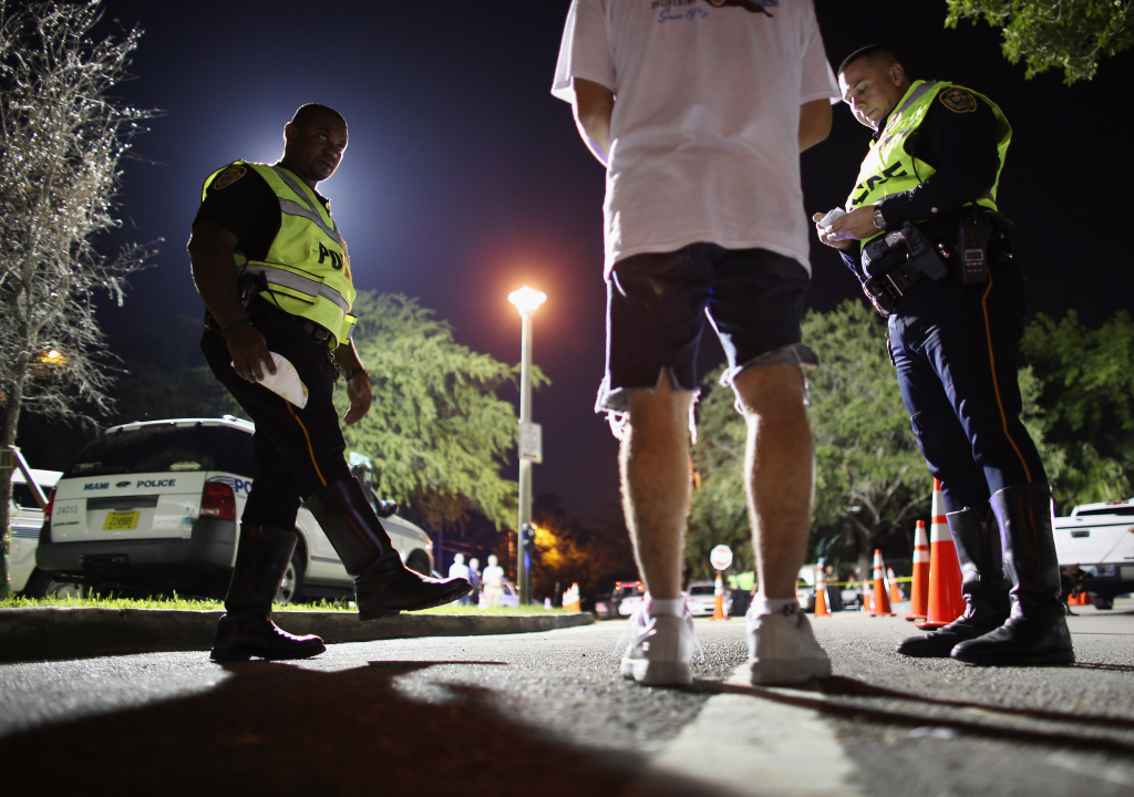 North Miami Beach police officers conduct a field sobriety test on a driver during a DUI checkpoint on May 23, 2013 in Miami, Florida.