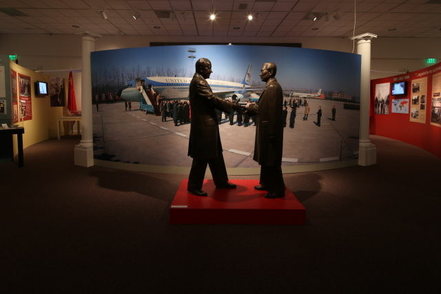 Two bronze statues of Richard Nixon and Chou en-Lai compliment a mural of Air Force One after it touched down in Peking, China in February 1972.