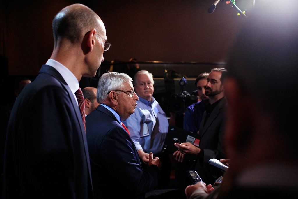 NBA Commissioner David Stern (C) and NBA Deputy Commissioner Adam Silver (L) speak  to members of the media after a press conference after the NBA and NBA Player's Association met to negotiate the CBA at The Helmsley Hotel on November 10, 2011 in New York City.