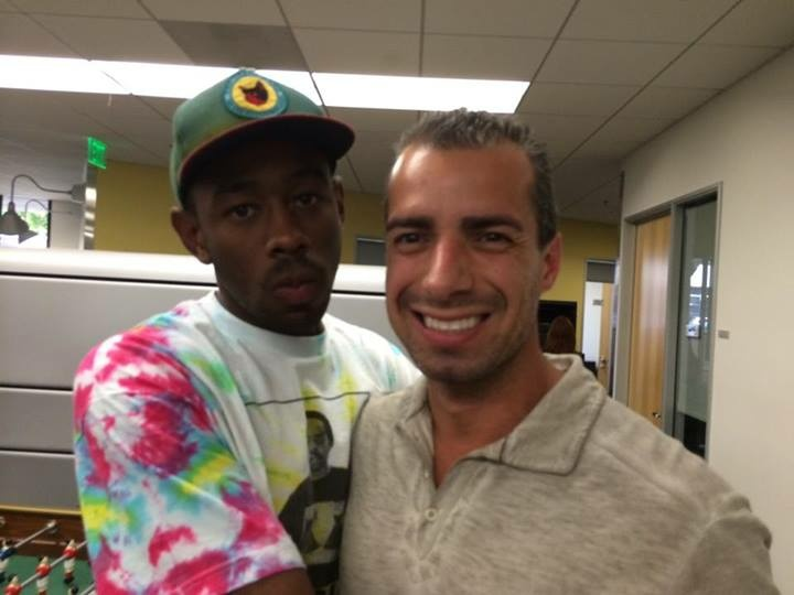 Tyler the Creator gives Take Two host A Martinez a big hug after their interview.