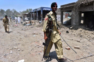 Pakistani paramilitary soldiers patrol following a suicide bomb attack in the district of Mohmand