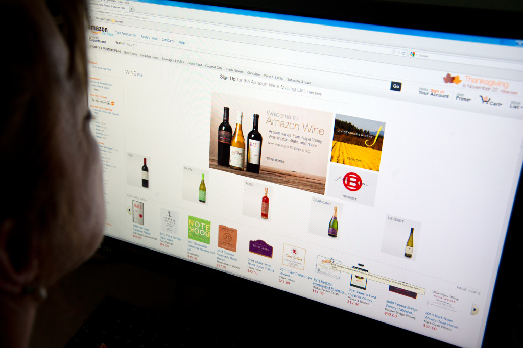 A woman shops for wine on Amazon's Internet site on November 8, 2012 in Washington, DC. Amazon on Thursday launched an online wine store selling 'more than a thousand' varieties of US vintages. Amazon said the online shop would be 'a marketplace offering customers more than a thousand wines crafted by wineries around the country.' Wine sales are allowed only in states which allow it. That includes California, Connecticut, Florida, Idaho, Illinois, Iowa, Nebraska, Nevada, North Carolina, Oregon, Washington, Wyoming and the District of Columbia.