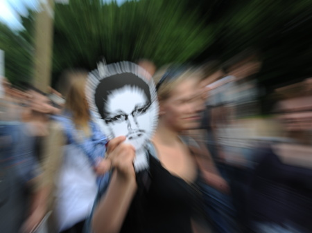 Former National Security Agency contractor Edward Snowden, who spilled secrets about the NSA's surveillance programs, has been condemned by U.S. officials. But he's been praised by some people around the world. In Berlin this week, supporters carried his
