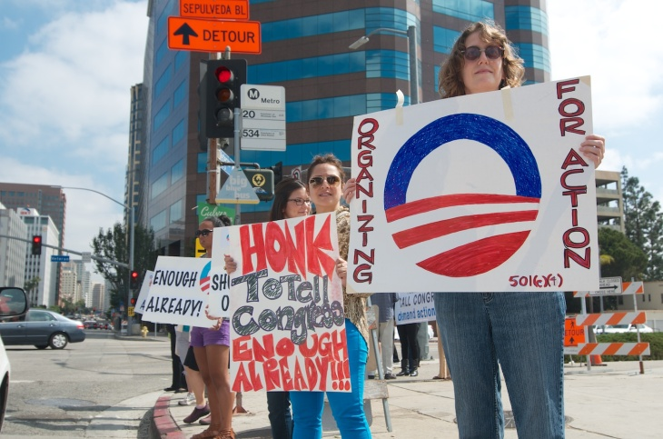 Barbara Samuels, an Organizing for Action volunteer, protests outside the Federal Building on Wilshire the second day of the government shutdown.