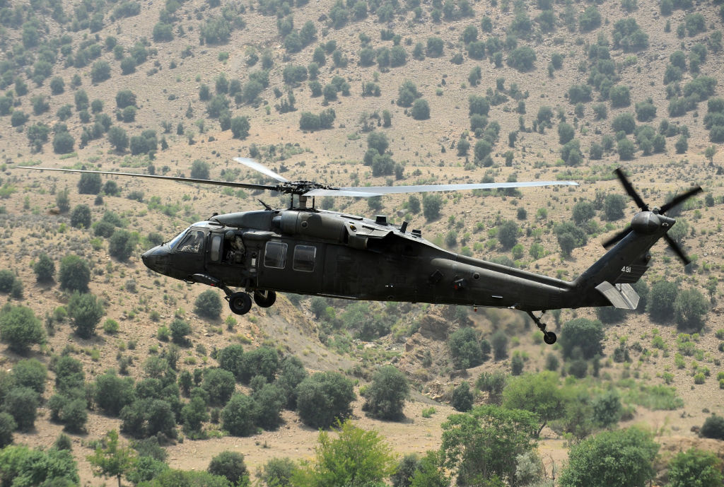 A US Blackhawk army helicopter flies over the mountainous area of Gorbuz district, on the border with Pakistan in Khost province, east of Afghanistan on June 28, 2011. Gorbuz district is a strategic area where goods as well as insurgents cross into Afghanistan from Pakistan.