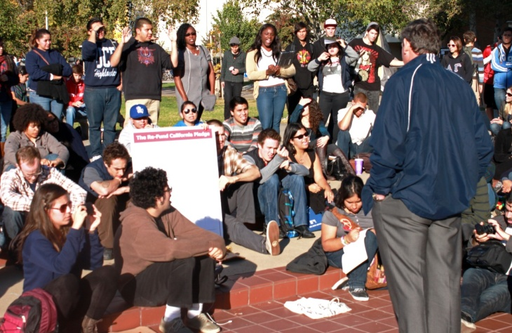 UC Riverside Chancellor Timothy White addresses students during campus Occupy rally on Monday.