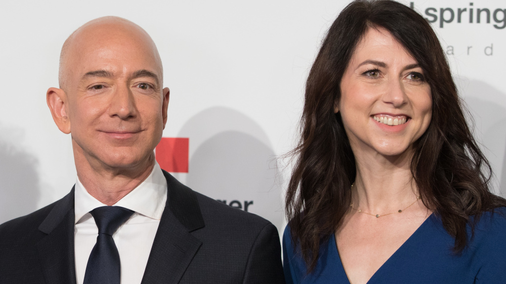 MacKenzie Bezos, one of the wealthiest women in the world, says she'll give at least half her fortune to charity. She's seen here in April 2018 with her former husband, Amazon founder Jeff Bezos.