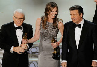 Director Kathryn Bigelow (C), winner of Best Director award for 'The Hurt Locker,' with co-hosts Steve Martin and Alec Baldwin, onstage during the 82nd Annual Academy Awards held at Kodak Theatre on March 7, 2010 in Hollywood, California.