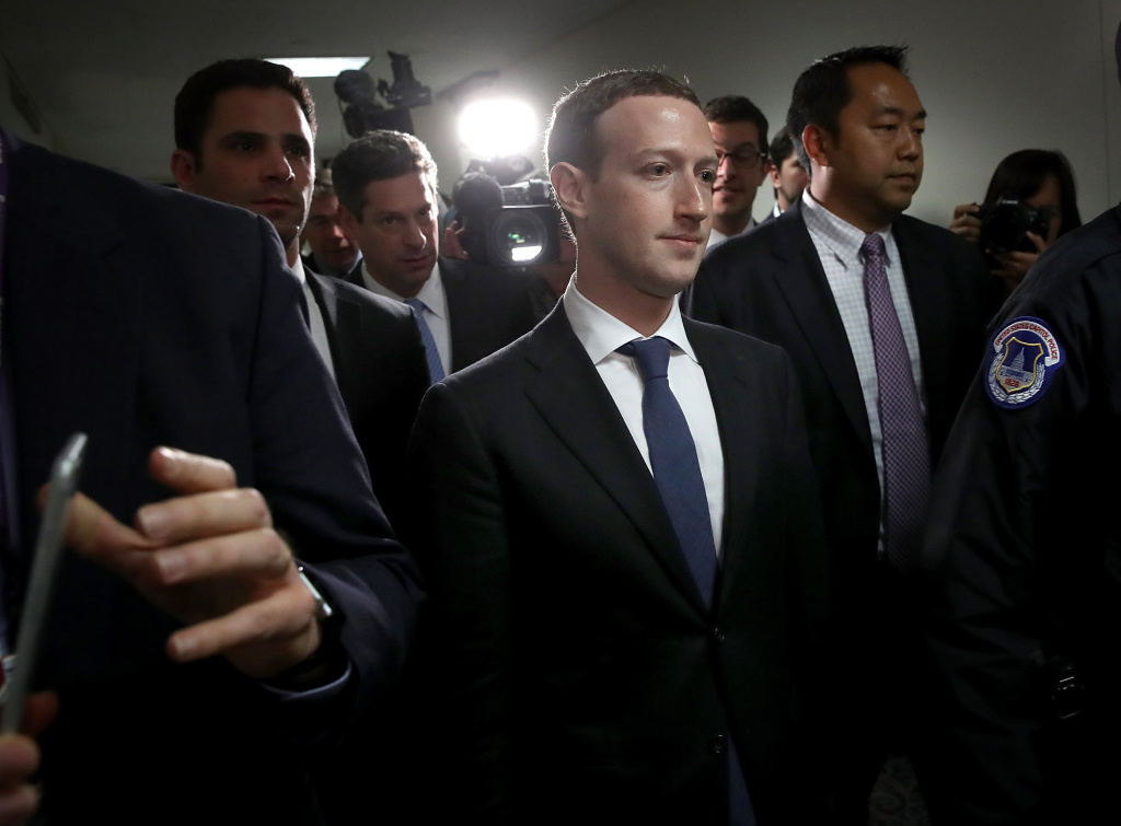 Facebook CEO Mark Zuckerberg (C) leaves the office of Sen. Dianne Feinstein (D-CA) after meeting with Feinstein on Capitol Hill on April 9, 2018 in Washington, DC.