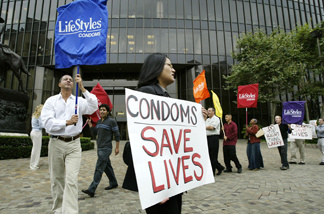 Protesters holding banners that look like giant condoms call on pornography executive Larry Flynt to voluntarily adopt a 100% condom use policy in his sexually explicit films, during a demonstration by the AIDS Healthcare Foundation outside the Flynt Publications building on June 7, 2004 in Los Angeles, California.