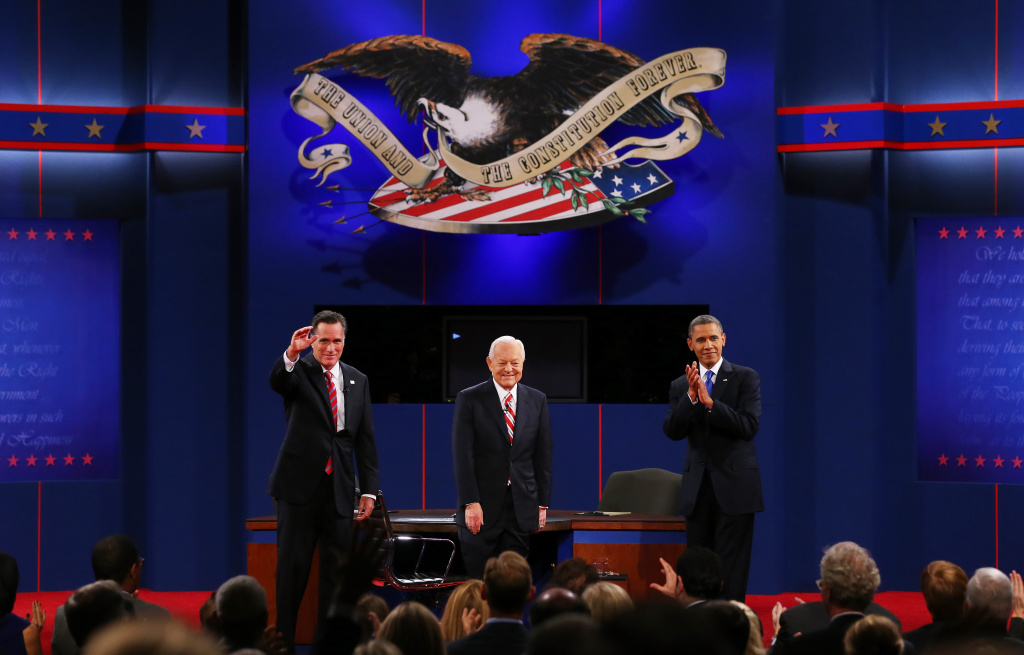 U.S. President Barack Obama (R) stands on stage with Republican presidential candidate Mitt Romney (L) and moderator Bob Schieffer of CBS at the Keith C. and Elaine Johnson Wold Performing Arts Center at Lynn University on October 22, 2012 in Boca Raton, Florida. The focus for the final presidential debate before Election Day on November 6 is foreign policy.
