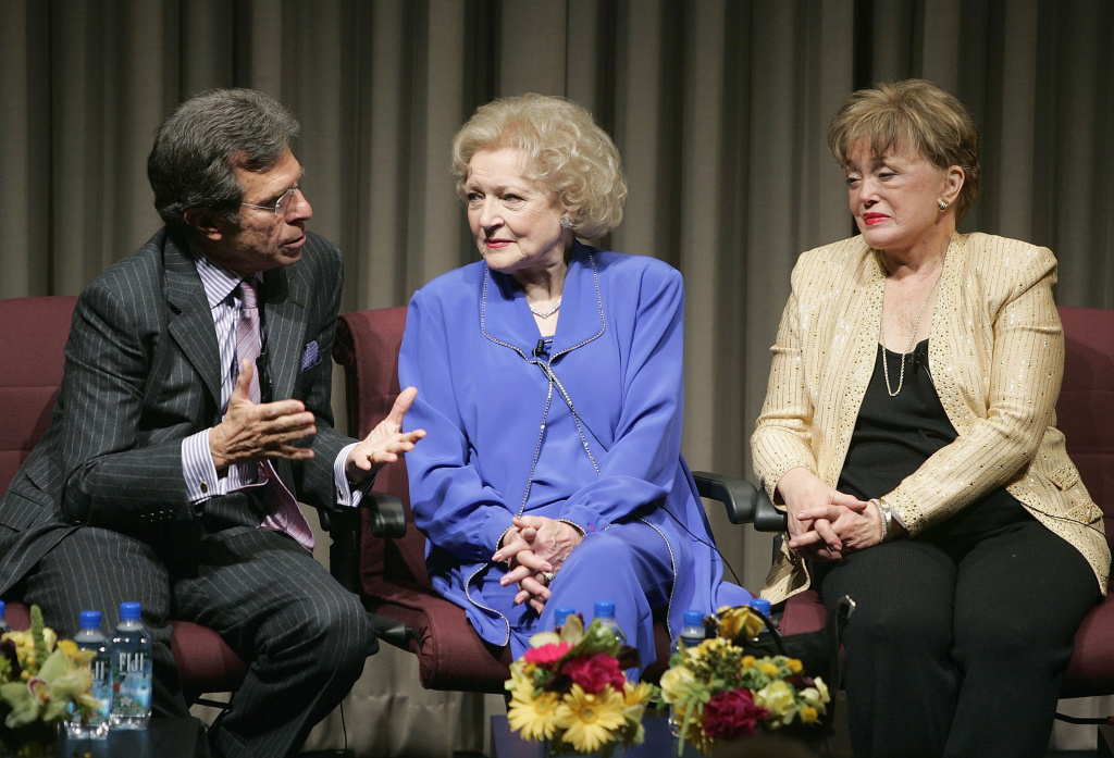 Producer Paul Junger Witt talks as actresses Betty White and Rue McClanahan listen during the Q&A for the DVD release party for the first season of