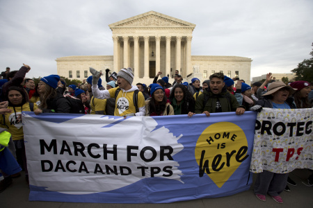 """Demonstrators arrive in front of the US Supreme Court during the """"Home Is Here"""" March for Deferred Action for Childhood Arrivals (DACA), and Temporary Protected Status (TPS) on November 10, 2019 in Washington D.C."""