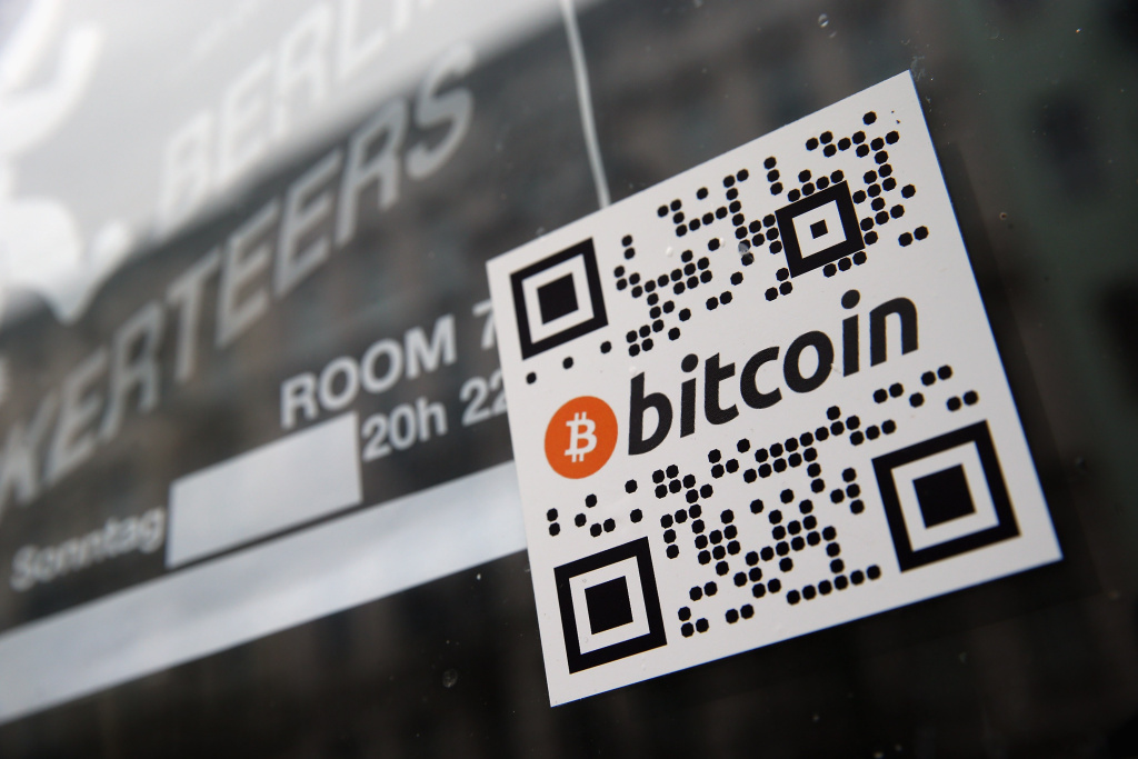 A sticker on the window of a local pub indicates the acceptance of Bitcoins for payment on April 11, 2013 in Berlin, Germany.