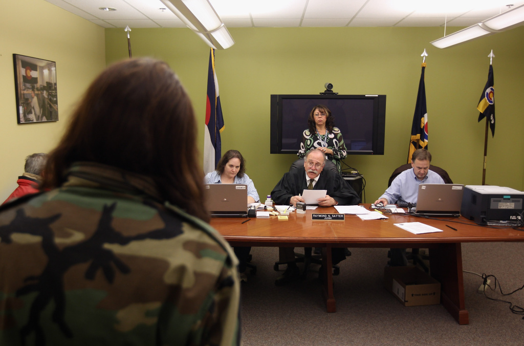 A judge hears a homeless veteran's case at a makeshift Denver city and county court, Denver, Colorado, 2011.