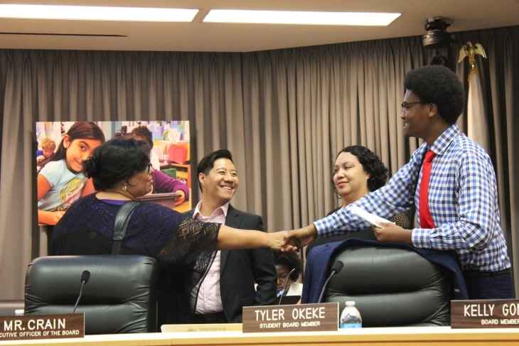 Mónica García (left), president of the Los Angeles Unified School Board, shakes hands with Tyler Okeke, the LAUSD board's non-voting student representative.
