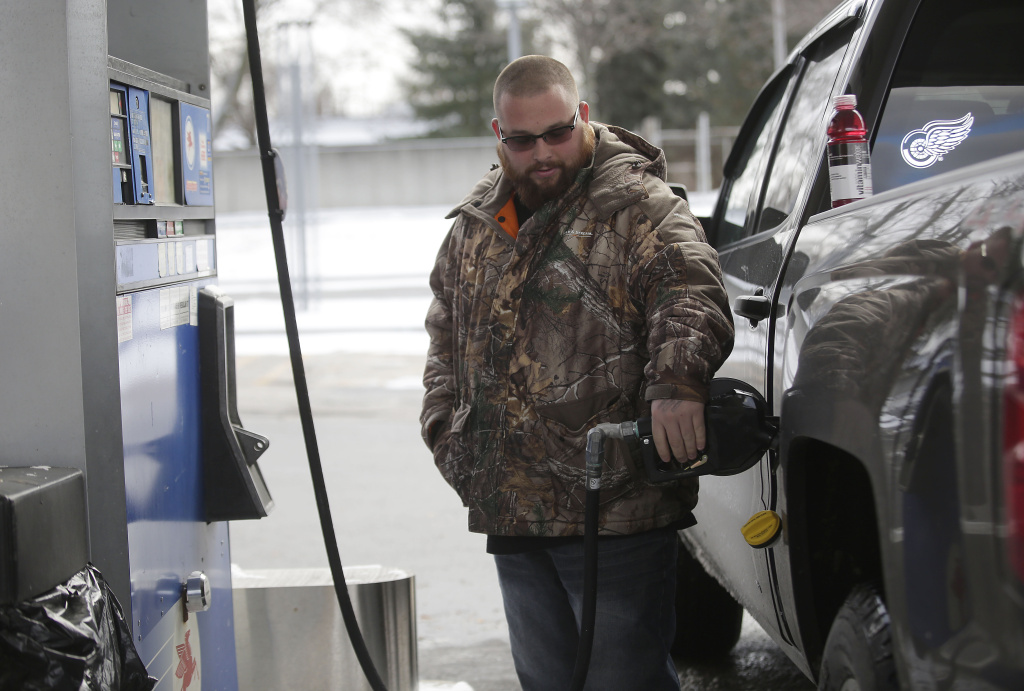 A motorist fills his vehicle with fuel at a Mobil station.