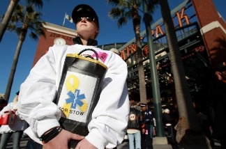 Laurie Condren of San Jose holds a collection bucket for Giants fan Bryan Stow the week after his attack on April 11, 2011 in Los Angeles.
