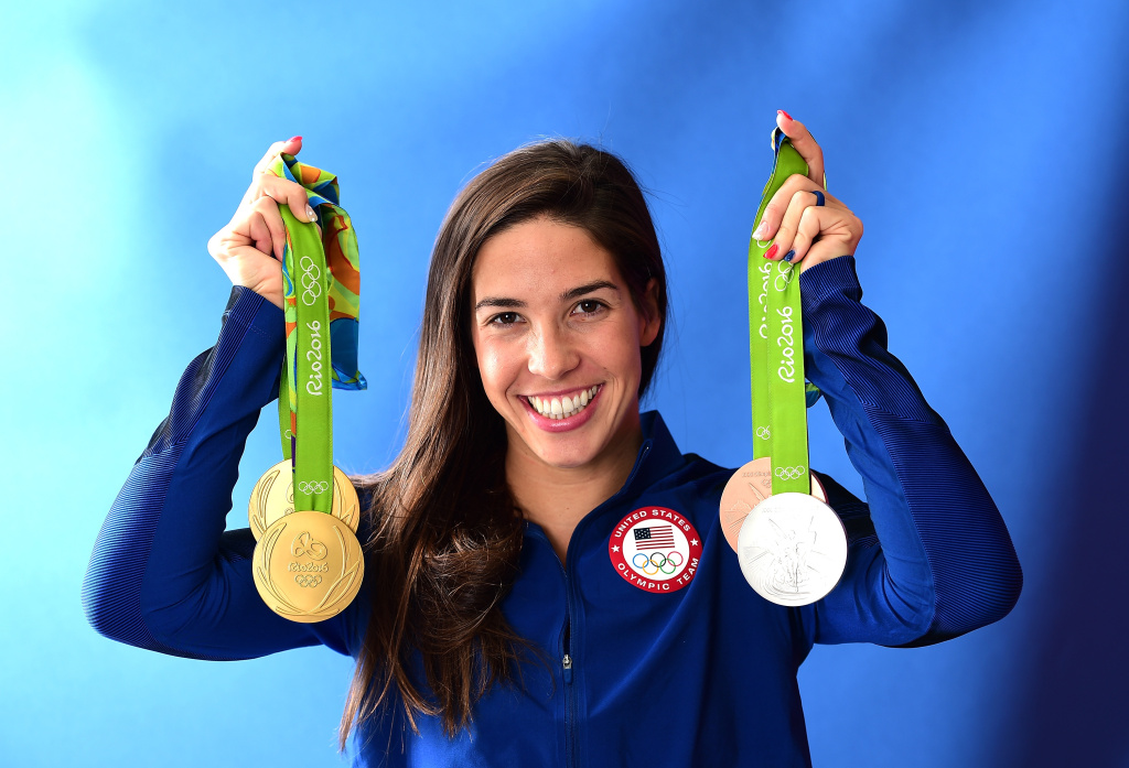 Swimmer Maya DiRado of the United States poses for a photo with her four medals on the Today show set on Copacabana Beach on August 13, 2016 in Rio de Janeiro, Brazil. DiRado is from Sonoma County and attended Stanford University.