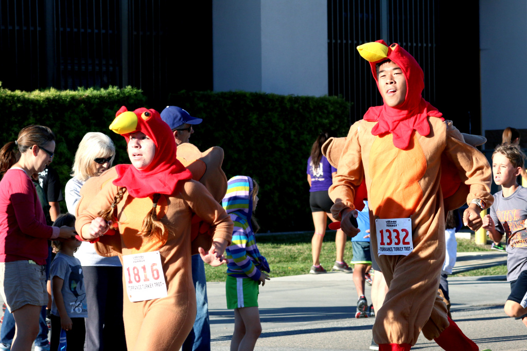 Some runners in costume run in the annual Harry Sutter Memorial Thanksgiving Day Turkey Trot Fun Run in Torrance.