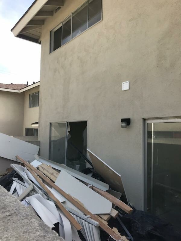 An explosion in an apartment building in Torrance Sunday left four people injured and two residential units significantly damaged.