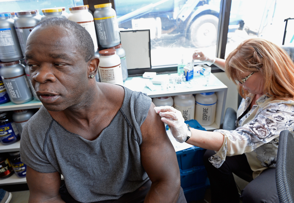 Mike Yarn (L) receives a free meningitis vaccine from registered nurse Margorie Barr at the AIDS Healthcare Foundation pharmacy on April 15, 2013 in Hollywood, California.