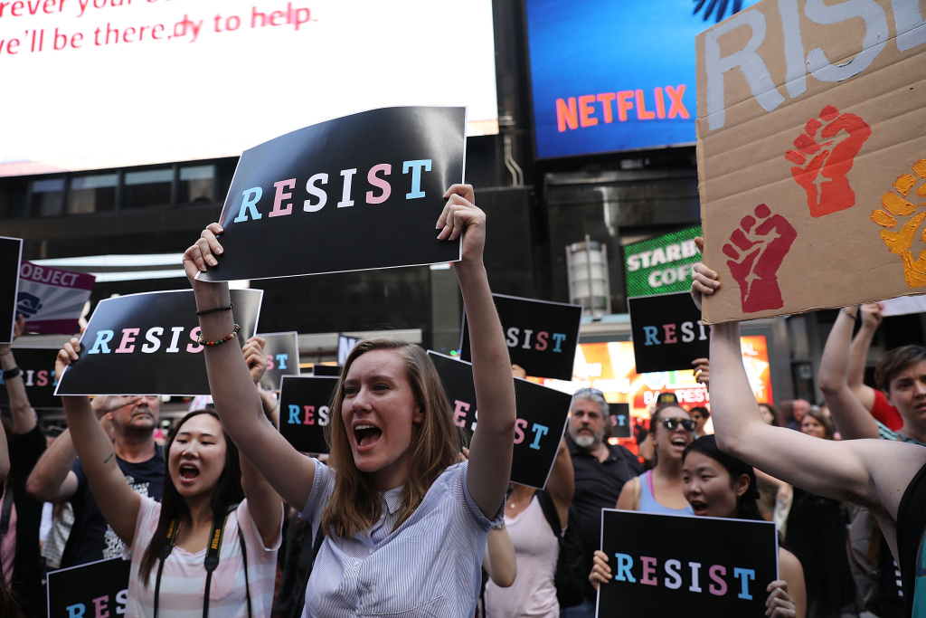 Dozens of protesters gather in Times Square near a military recruitment center to show their anger at President Donald Trump's decision to reinstate a ban on transgender individuals from serving in the military on July 26, 2017 in New York City.
