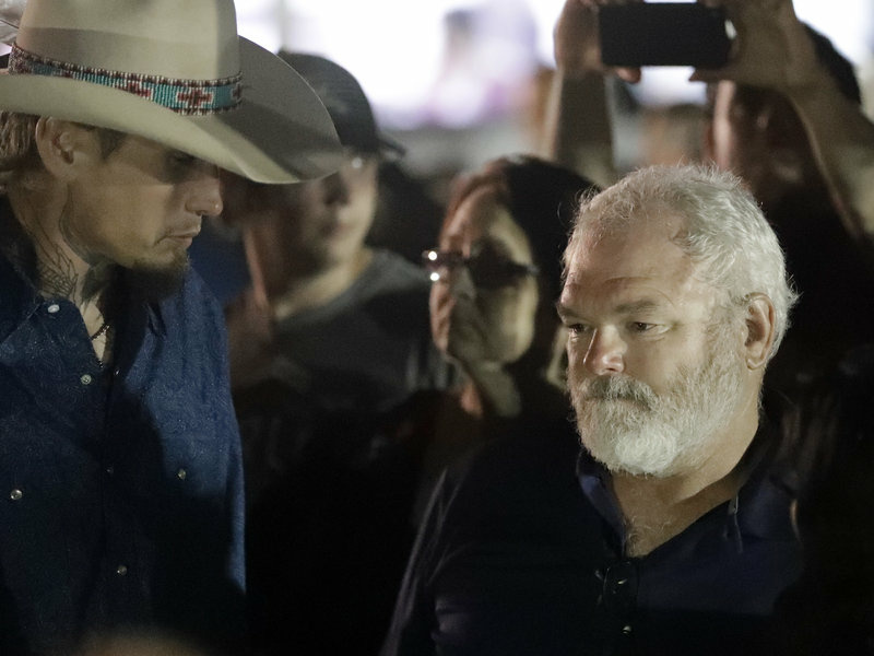 Stephen Willeford, right and Johnnie Langendorff, left, attend a vigil for the victims of the First Baptist Church shooting on Monday, in Sutherland Springs, Texas. Willeford shot suspect Devin Patrick Kelley, and Langendorff drove the truck while chasing Kelley.