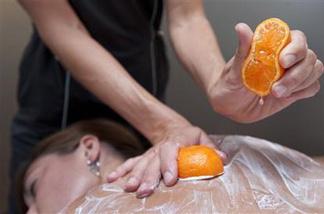 Body technician Bree Sarver demonstrates the pixie tangerine and pomegranate treatment on Andrea Olsonat the Ojai Valley Inn & Spa on Tuesday, Aug. 3, 2010 in Ojai, Calif.