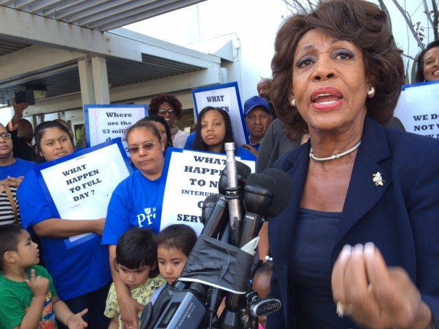 Congresswoman Maxine Waters surrounded by irate parents and their toddlers at the Los Angeles County Office of Education's Office in Downey
