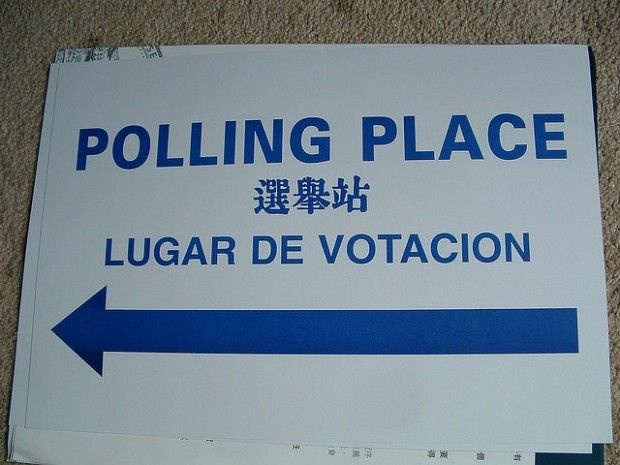A multilingual sign points the way to a polling place, November 2006