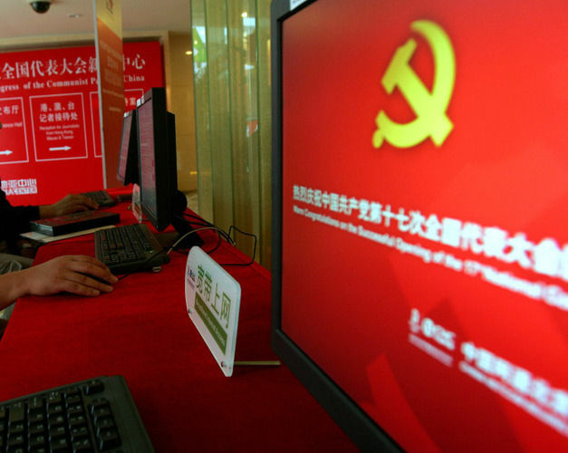 Staff members use computers at a press center in Beijing. Security experts say hacking of U.S. computers from China is becoming an increasing problem.