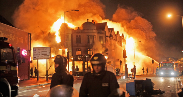 Firefighters battle a large fire that broke out in shops and residential properties in Croydon on August 9, 2011 in London, England. Sporadic looting and clashes with police continue for a third day in parts of the capital after the killing of the 29-year-old father of four Mark Duggan by armed police in an attempted arrest on August 4.