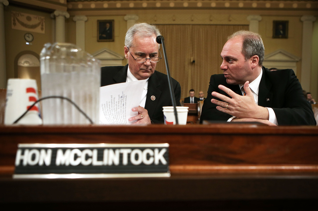 U.S. Rep. Tom McClintock (R-CA) (L) and Rep. Steve Scalise (R-LA) chat prior to a hearing before the Oversight Subcommittee of the House Ways and Means Committee April 10, 2013 on Capitol Hill in Washington, DC.