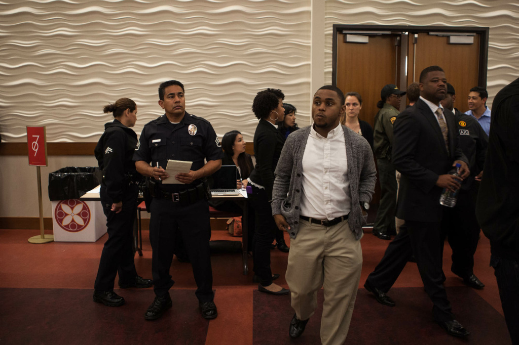 LAPD officers monitored the entrance to a hall where more than 700 students turned out to hear a panel with the LAPD and university officials.