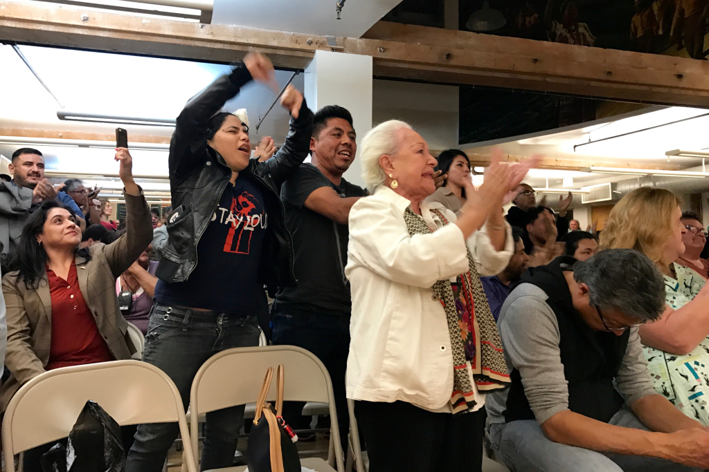 The audience erupts during a debate between City Council member Gil Cedillo and challenger Joe Bray-Ali on April 17, 2017.