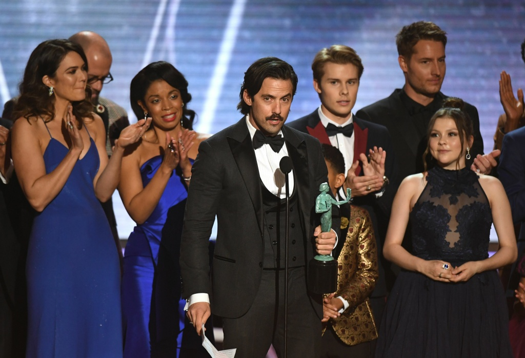 Milo Ventimiglia (C) and the cast from 'This Is Us' accept the award for Outstanding Performance by an Ensemble in a Drama Series during the 24th Annual Screen Actors Guild Awards show at The Shrine Auditorium on January 21, 2018 in Los Angeles, California.
