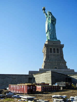 The Statue of Liberty survived Sandy unscathed, but Liberty Island remains closed indefinitely as workers remove mud and debris.