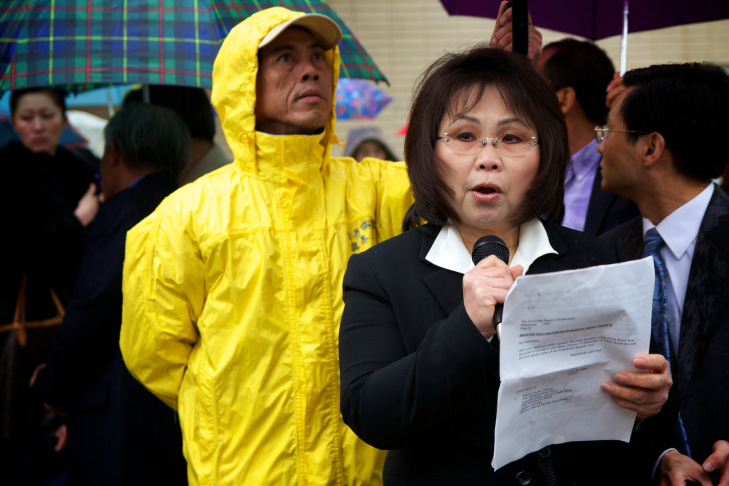 Dozens of Falun Gong practitioners faced the rain this morning to gather outside of the LA Chinese Consulate.