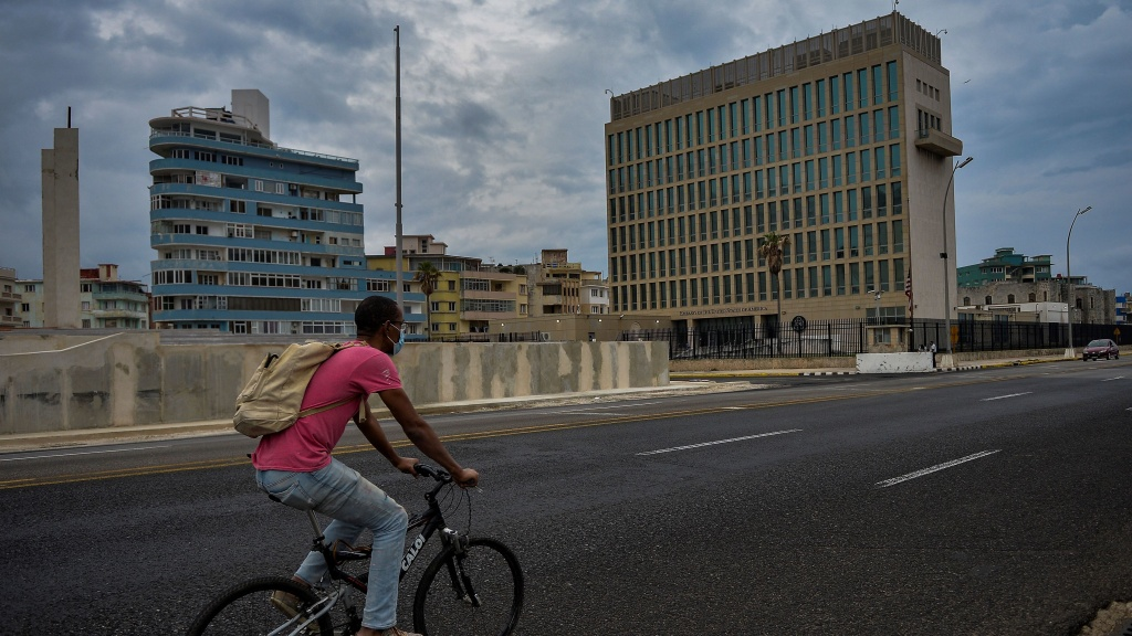 A man rides his bicycle near the U.S. Embassy in Havana on Jan. 12.