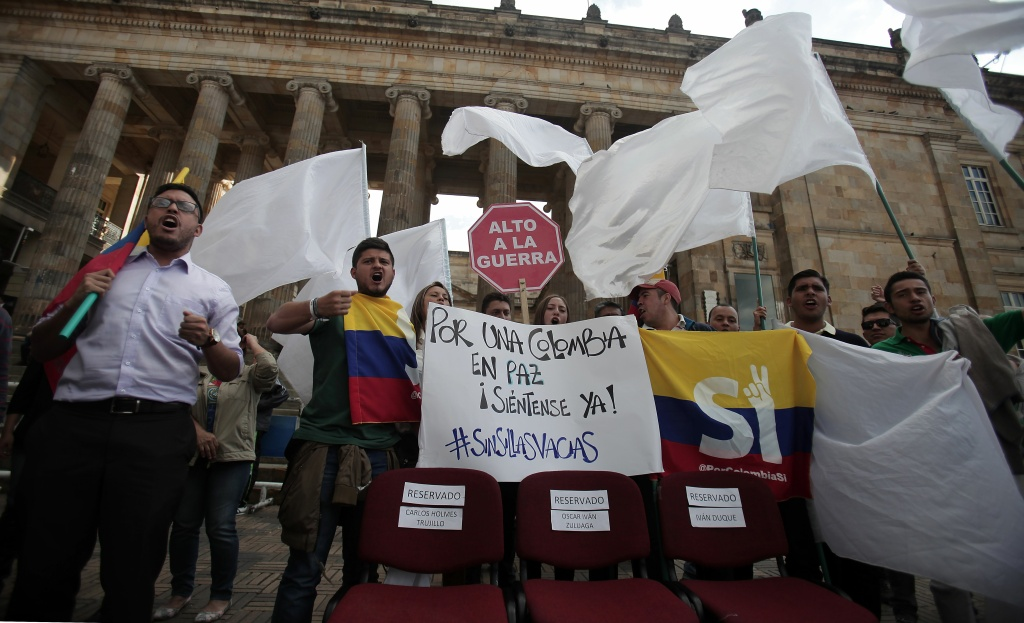 University students and supporters of the peace deal signed between the government and the Revolutionary Armed Forces of Colombia (FARC) rebels protest with a sign reading