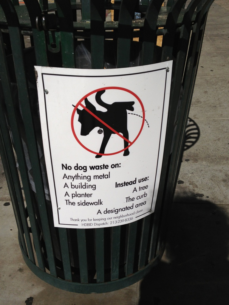 New signs throughout downtown LA implore dogs to watch where they do their business.