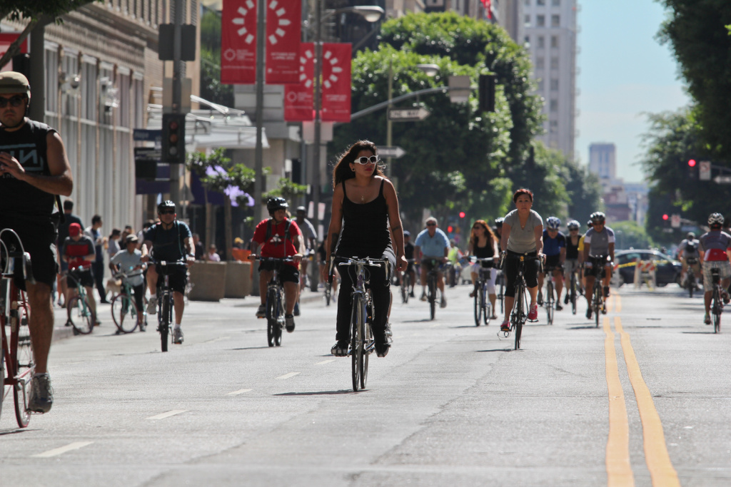 Cyclists ride through the street at CicLAvia in downtown L.A. October 9, 2011.