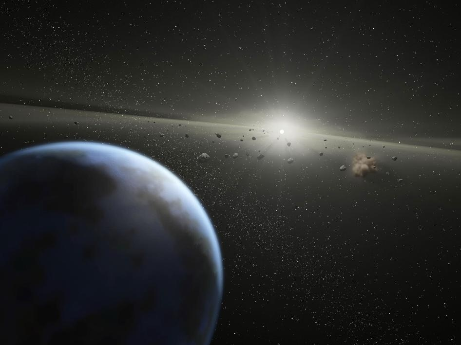 A NASA artist's illustration depicts an asteroid belt around a star that the space agency says is