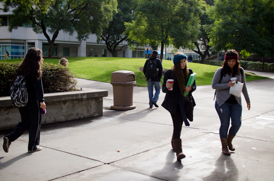 Gabrielle Dewberry runs to class with her assignment in hand the morning after Cal State-Fullerton was placed on lock down when a robbery suspect was believed to have barricaded himself inside one of the buildings.