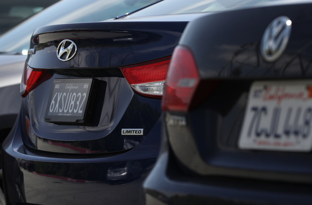 A digital license plate made by Bay Area company Reviver Auto, part of a pilot project with the state Department of Motor Vehicles, is displayed on a car at Reviver Auto headquarters on May 30, 2018 in Foster City, California