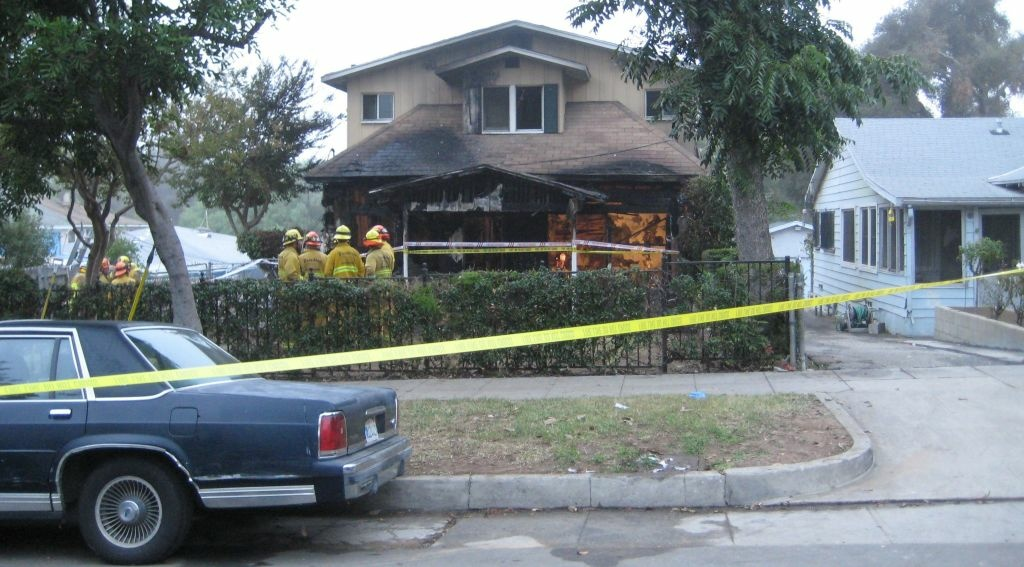 Investigators are trying to determine what started a fire at this Pasadena home that killed two men.