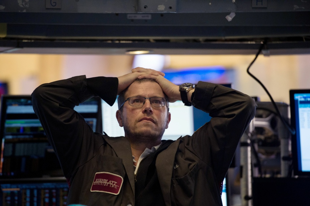 A trader works on the floor at the closing bell of the Dow Industrial Average at the New York Stock Exchange on February 5, 2018 in New York.